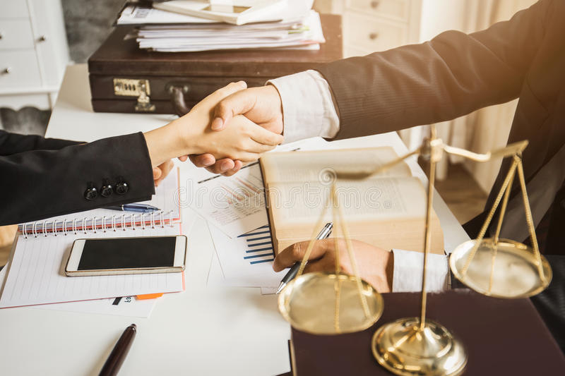 The hard work of an asian lawyer in a lawyer office. Counseling and giving advice and prosecutions about the invasion of space between private and government royalty free stock photography