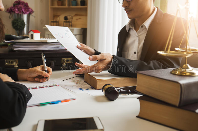 The hard work of an asian lawyer in a lawyer office. Counseling and giving advice and prosecutions about the invasion of space between private and government royalty free stock image
