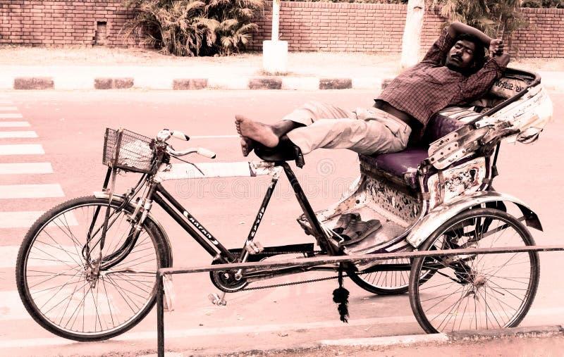 Hard worker slept in chandigarh india. Hard worker sleeping on rickshaw, chandigarh, India royalty free stock photos