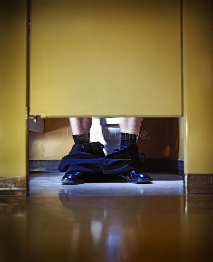 Hard worker on toilet stock photo