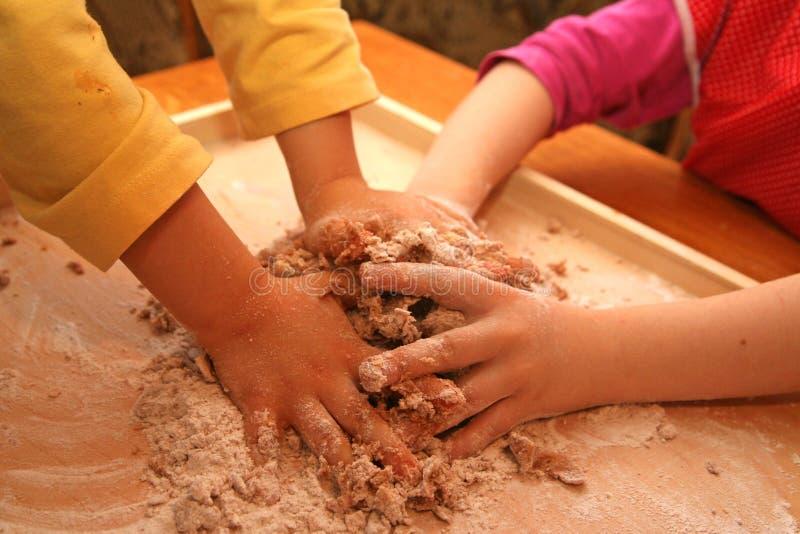 Hard working children. Making cake royalty free stock image