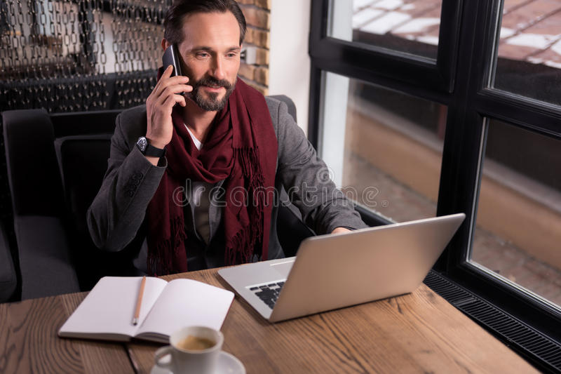 Hard working confident businessman having a phone conversation royalty free stock images