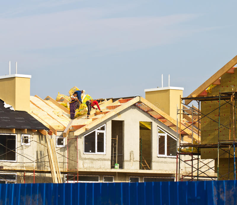 Download Hard Working Men on Roof stock photo. Image of house - 26713022