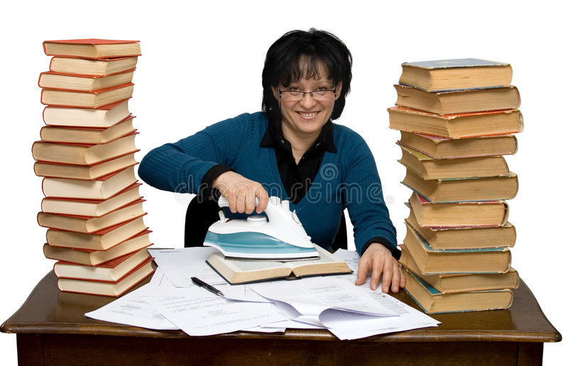 Hard working woman. In a library isolated royalty free stock image