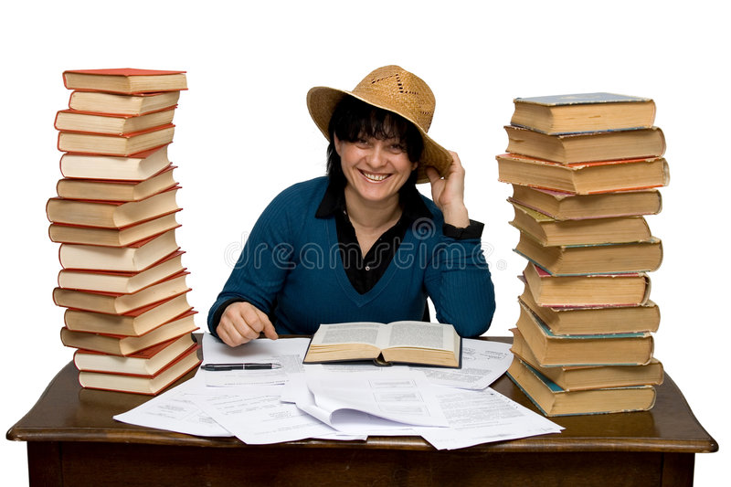 Hard working woman. In a library isolated stock images