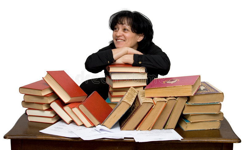 Hard working woman. In a library isolated stock photography
