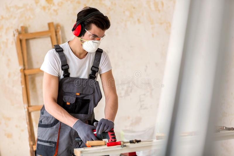 Hard working young man applying finishing touches royalty free stock photos