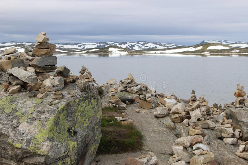 The Hardangervidda Plateau in Hallingskarvet National Park, Norway, Europe, with lake Ustevatn. In August, there is still snow on the mountains stock image