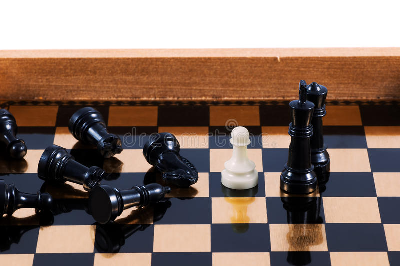 Hardcore chess pawn. Chess pawn vs king and queen stock image
