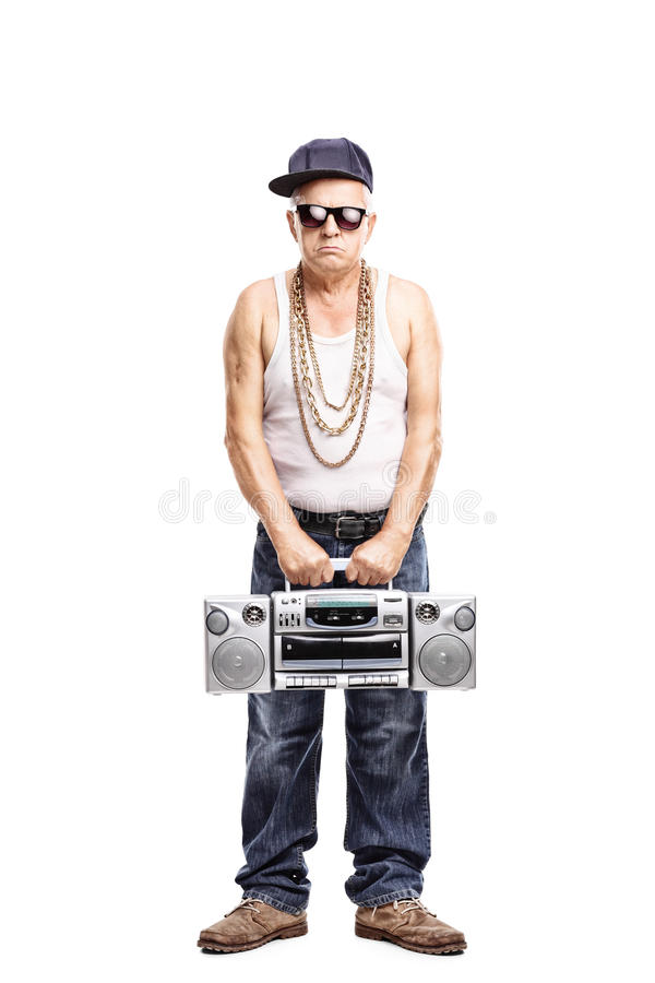 Hardcore rapper holding a ghetto blaster. Full length portrait of a hardcore rapper holding a ghetto blaster and looking at the camera isolated on white stock photo