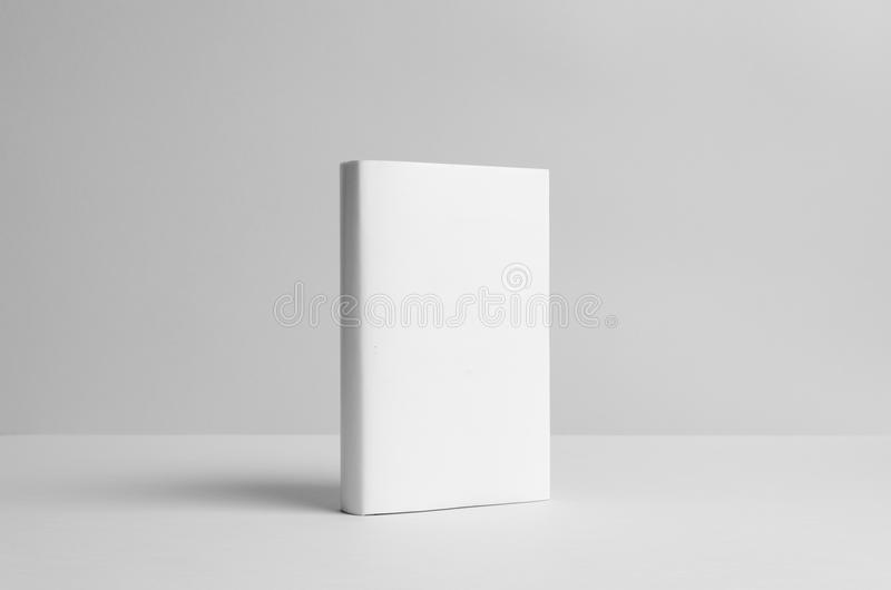 Hardcover Book Mock-Up - Dust Jacket. Front. Wall Background stock image