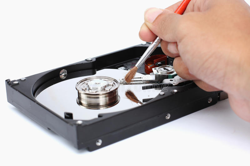 Harddisk cleaner. On a white background royalty free stock photography