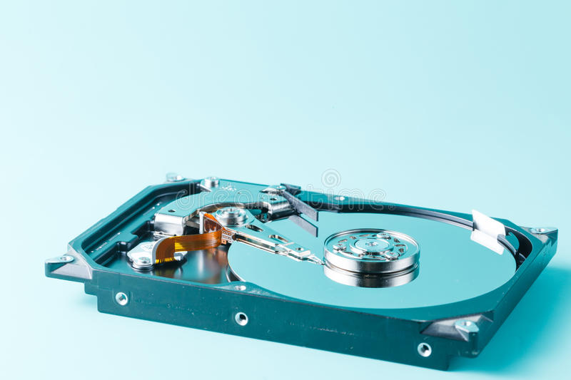 Harddisk drive (HDD) with top cover open. On aquamarine background royalty free stock images