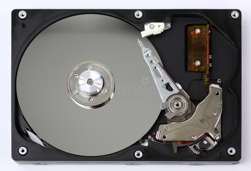 Harddisk drive HDD. With top cover open on white background royalty free stock photos