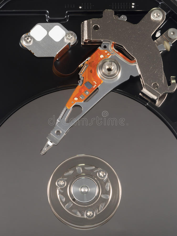 Harddisk drive isolated. Harddisk drive with top cover open isolated stock photo