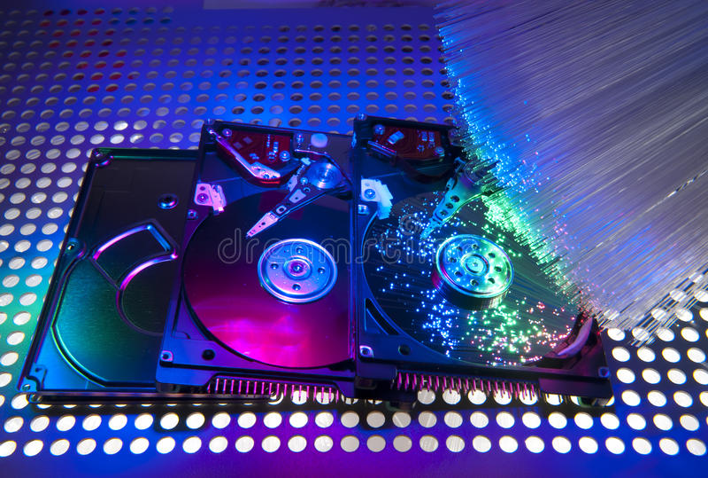 Harddisk on with fiber optical stock images