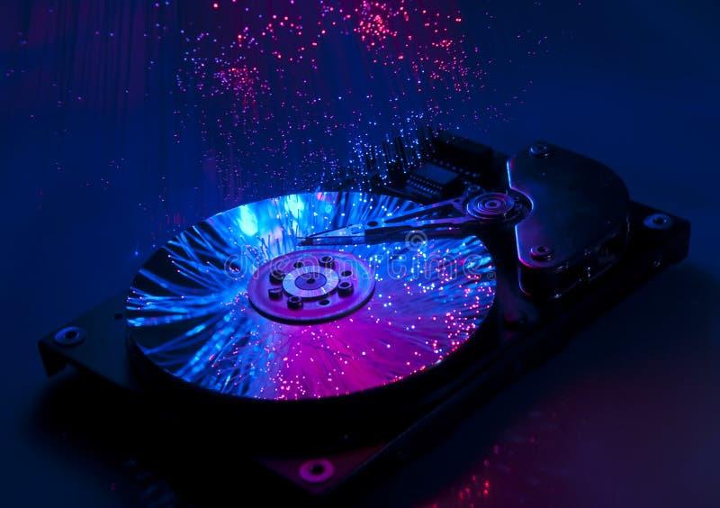 Harddisk with fiber optical background royalty free stock photography