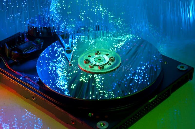 Harddisk with fiber optical background stock photography