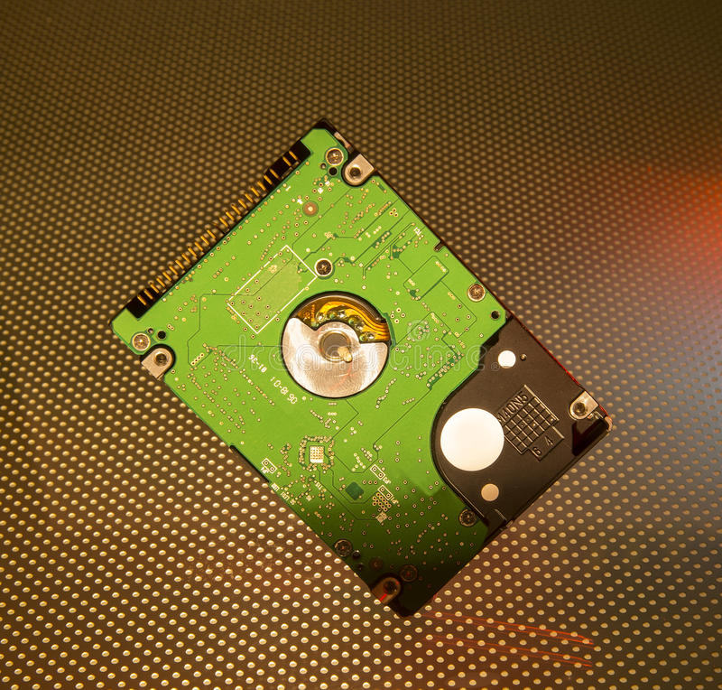 Harddisk with fiber optical stock photo