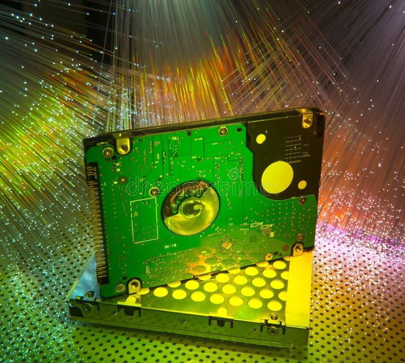 Harddisk with fiber optical stock photography