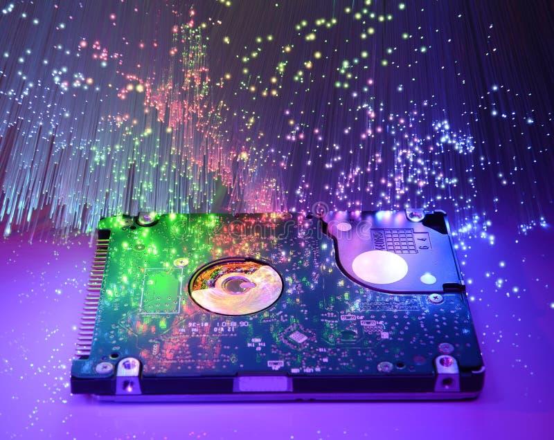 Harddisk with fiber optical background stock photo