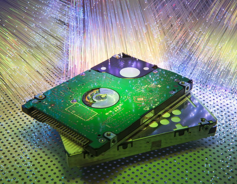 Harddisk with fiber optical background royalty free stock photo
