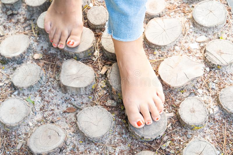 Hardening feet barefoot walking to different surfaces and temperatures according to Sebastian Kneipp philosophy.  stock images