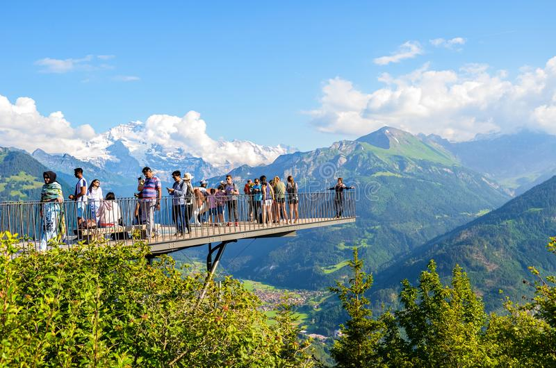 Harder Kulm, Interlaken, Switzerland - July 16 2019: Tourists taking photo on viewing platform above Swiss Interlaken. Alps in royalty free stock photo