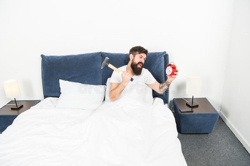 Hardest moment of day. It is totally normal to hate your alarm sound. Hateful schedule. Best alarm clocks for people who. Hate mornings. Man bearded hipster royalty free stock photo