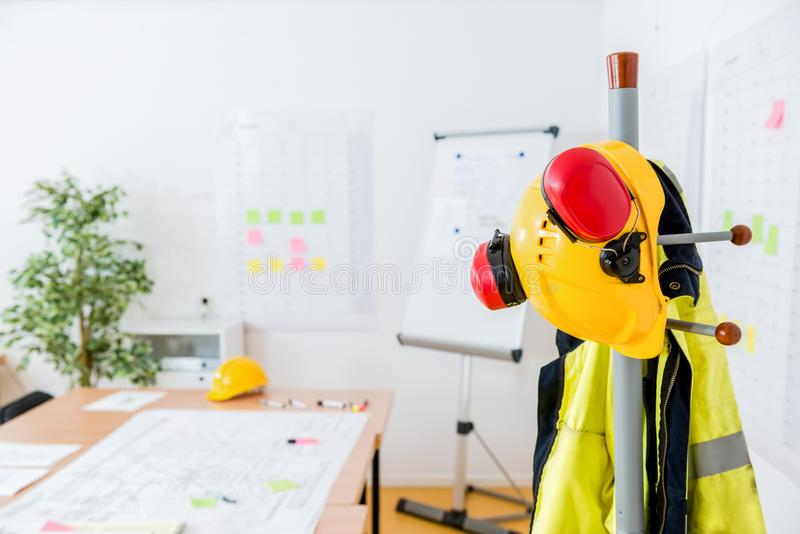 Hardhat And Earmuffs On Rack In Office stock image