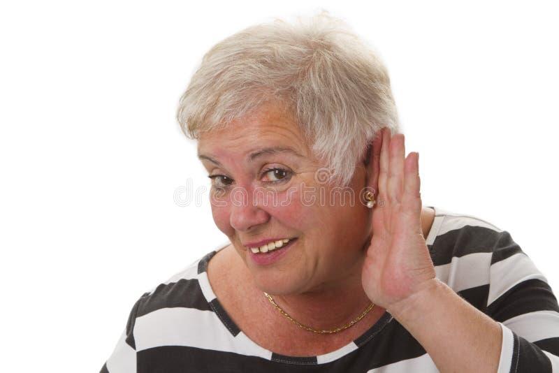 Hardness of hearing. Isolated on white background stock images