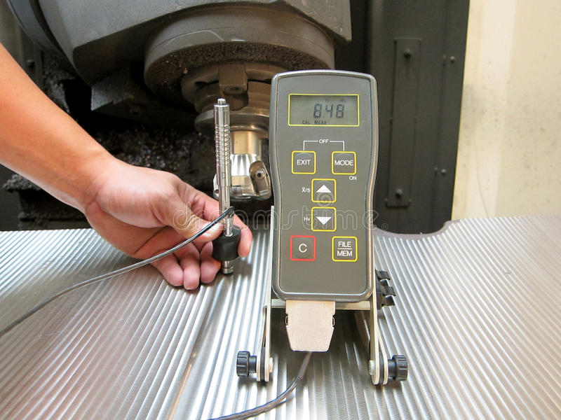 Hardness measurement. Operator check hardness of machine surface, Manufacturing of cast iron stock images