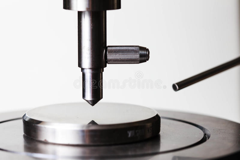 Hardness test with standard block. Indenter of rockwell scale C hardness test stock photo