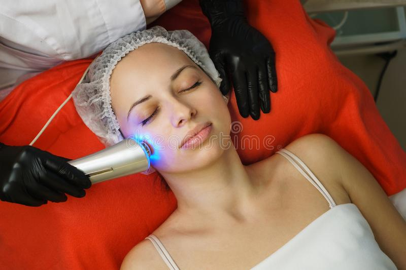 Hardware cosmetology. Ultrasonic face cleaning royalty free stock photo