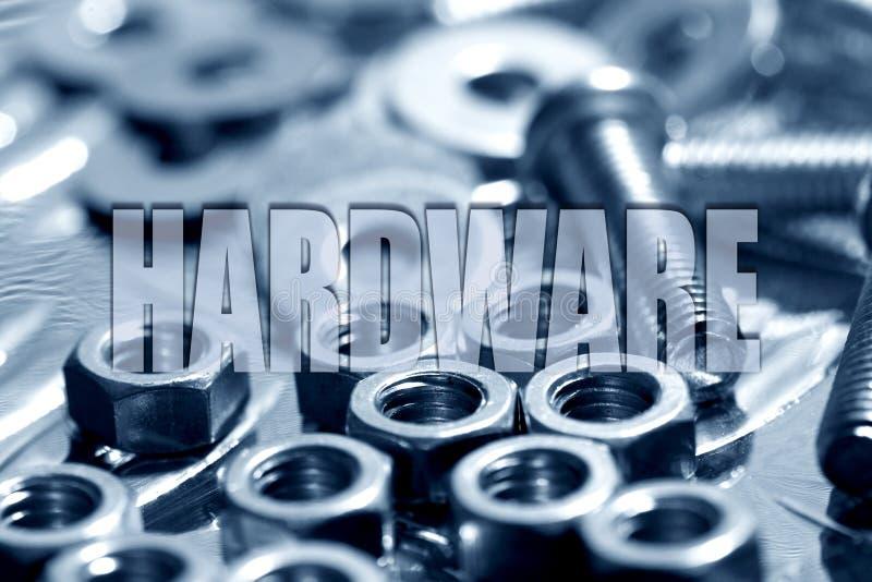 Hardware escrito sobre porcas - e - parafusos no azul imagem de stock royalty free