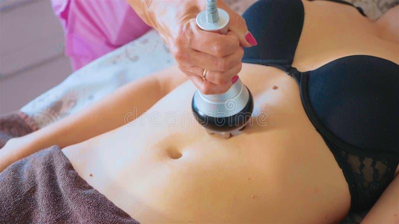 Hardware figure correction. Machine cosmetology. Anti-cellulite massage. royalty free stock photos