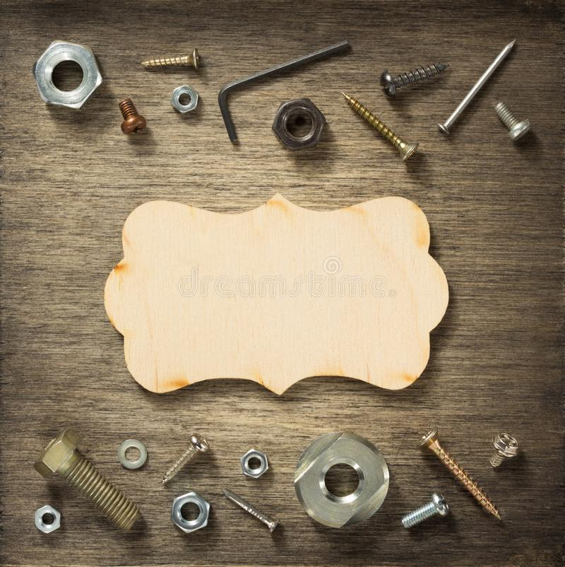 Hardware tools and screws at wood royalty free stock photo