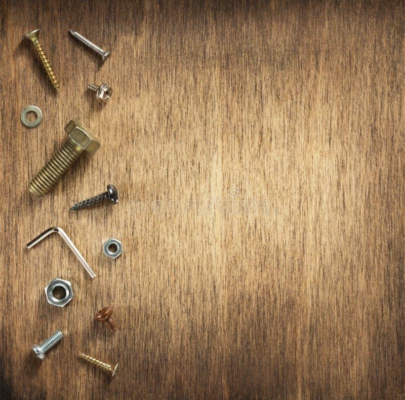 Hardware tools and screws at wood royalty free stock photos
