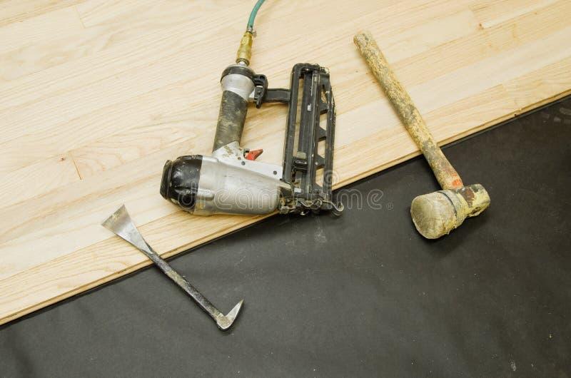 Hardwood Flooring Tools. Tools for the installation of hardwood flooring on a partly installed wood floor stock image