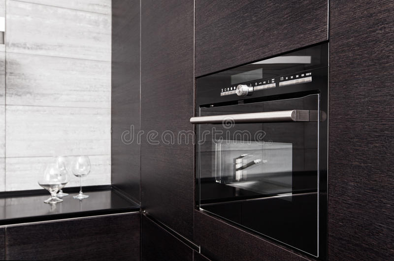 Hardwood Kitchen With Build-in Microwave Oven Stock Photography