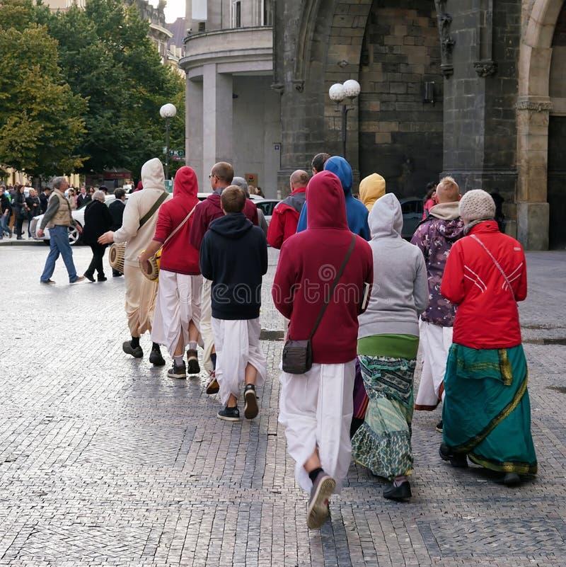 Hare Krishna followers. Walk through the Old Town of Prague stock photo