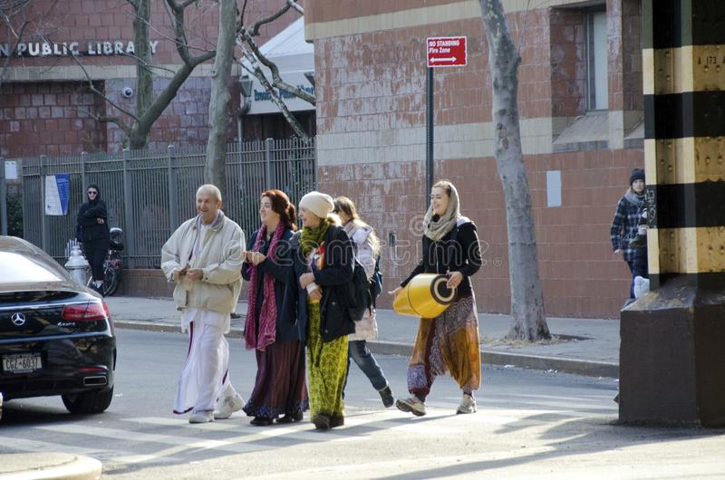 Hare Krishna. A group of members of the International Society for Krishna Consciousness religious sect walking on the streets of Brooklyn in New York City while royalty free stock images