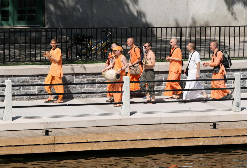 Hare Krishna Walking. OTTAWA, CANADA – JULY 1: Members of Hare Krishna chanting and walking alongside the Rideau Canal during Canada Day on July 1, 2011 stock photography