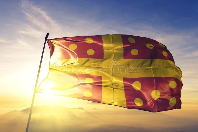 Harelbeke of West Flanders of Belgium flag waving on the top sunrise mist fog. Harelbeke of West Flanders of Belgium flag textile cloth fabric waving on the top royalty free stock photo