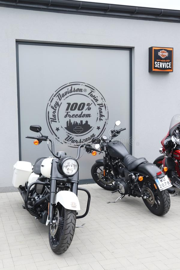 Harely Davidson service department sign and motorcycles in Warsaw, Poland. Harley Davidson motorcycles parked in front of a sign on a wall on the dealership stock photos
