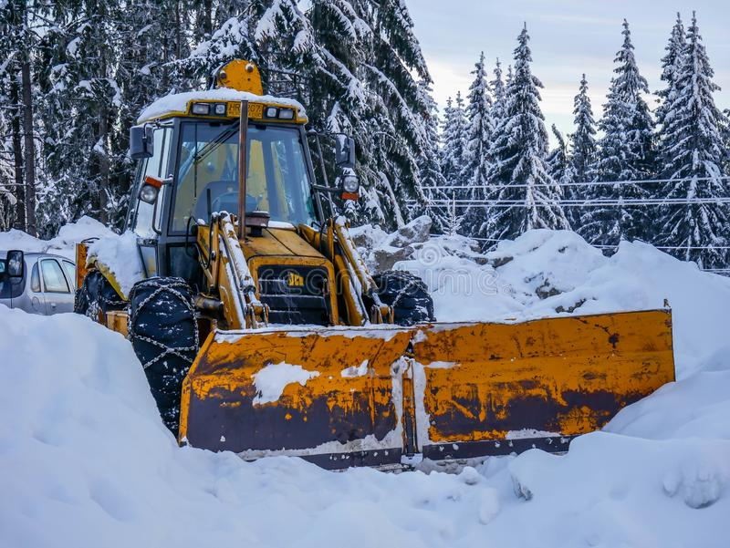 JCB excavator close up in the big snow . stock images