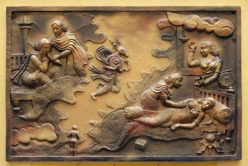 Hari-Naigamesin verwijdert het foetus uit Devanandas wom en brengt in het graf van koningin Trisala onder royalty-vrije stock afbeelding