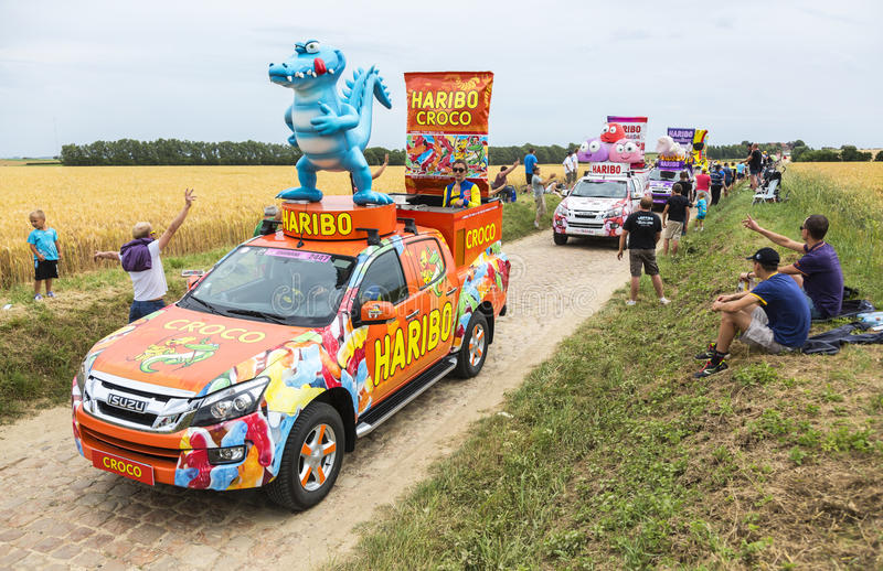 Haribo Caravan on a Cobblestone Road- Tour de France 2015. Quievy,France - July 07, 2015: Haribo Caravan during the passing of the Publicity Caravan on a royalty free stock photography