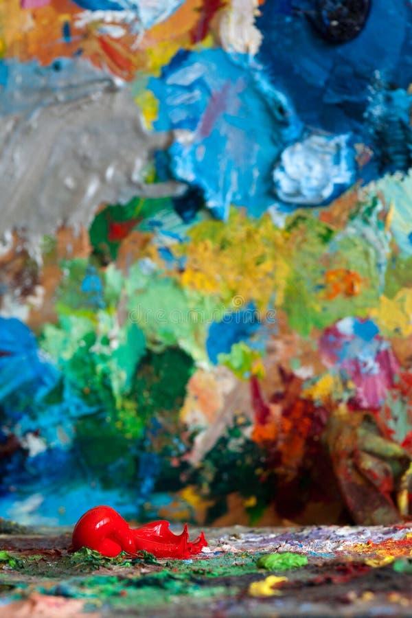 Haricot rouge sur les palettes de peintre images libres de droits