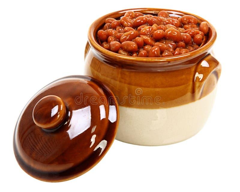 Haricots cuits au four dans le pot images stock